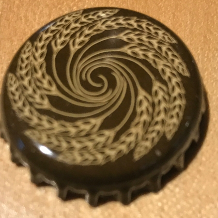 A bottle cap removed from a bottle of Bell's Double Cream Stout